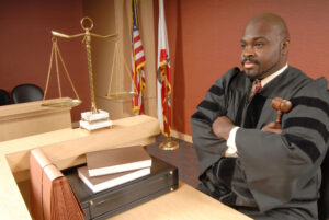 Judge sitting at the bench and listening to arguments avoiding contempt of court