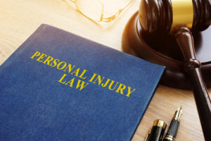 Personal injury law on a desk with gavel.