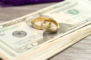 wedding bands on pile of cash representing a high asset divorce