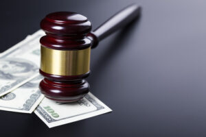 theft and property crimes hearing gavel on top of cash