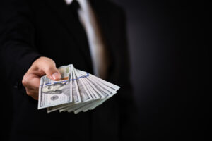 man presenting cash collection procedure